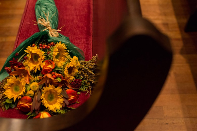 A bouquet of flowers rests on a pew at Christ Episcopal Church.