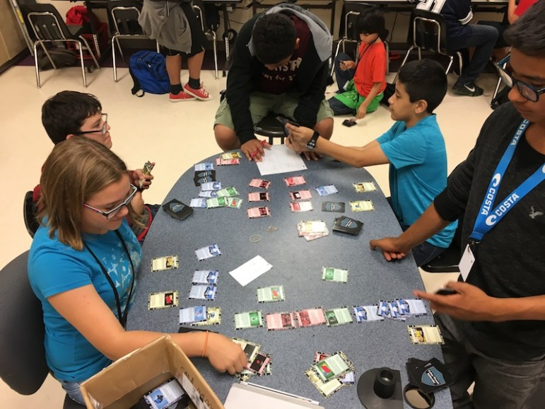 Kassidee Webb (l) and Trey Cano face off in a game of Cyber Threat Defender. Bekah McNeel / Rivard Report