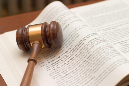 A gavel and a law book.