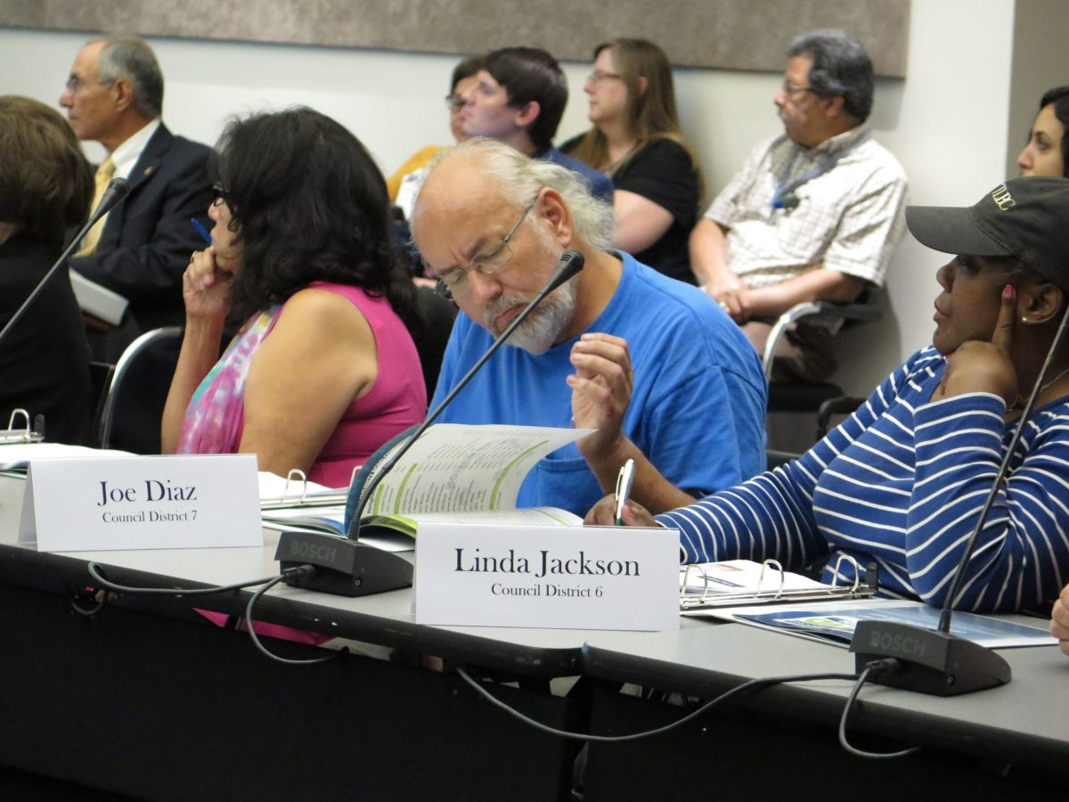 Drainage and Flood Control Committee member Joe Diaz reads through the proposed 2017 Bond projects during the meeting.