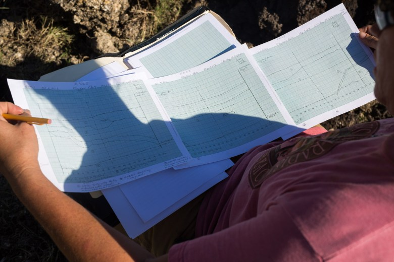 Reba Kistner Field Technician Cyndi Dickey studies her recent elevation marking of the discovered acequia.