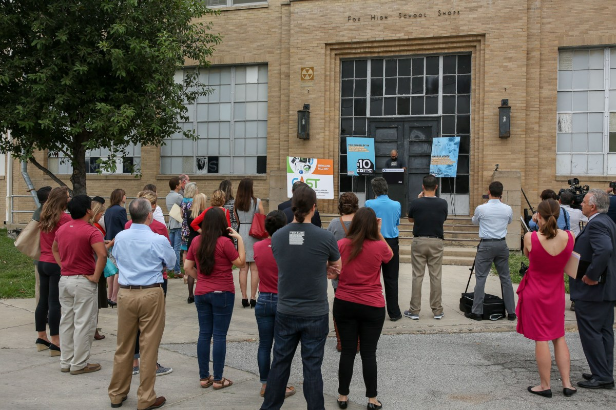 Members of the tech community gathered at the future entrance of CAST Tech on Tuesday morning.