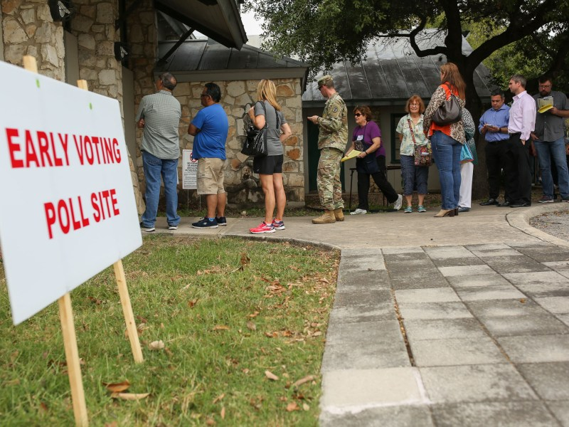 Early voters wait outside the Lions Field Adult & Senior Activity Center on Broadway Street North of Downtown.