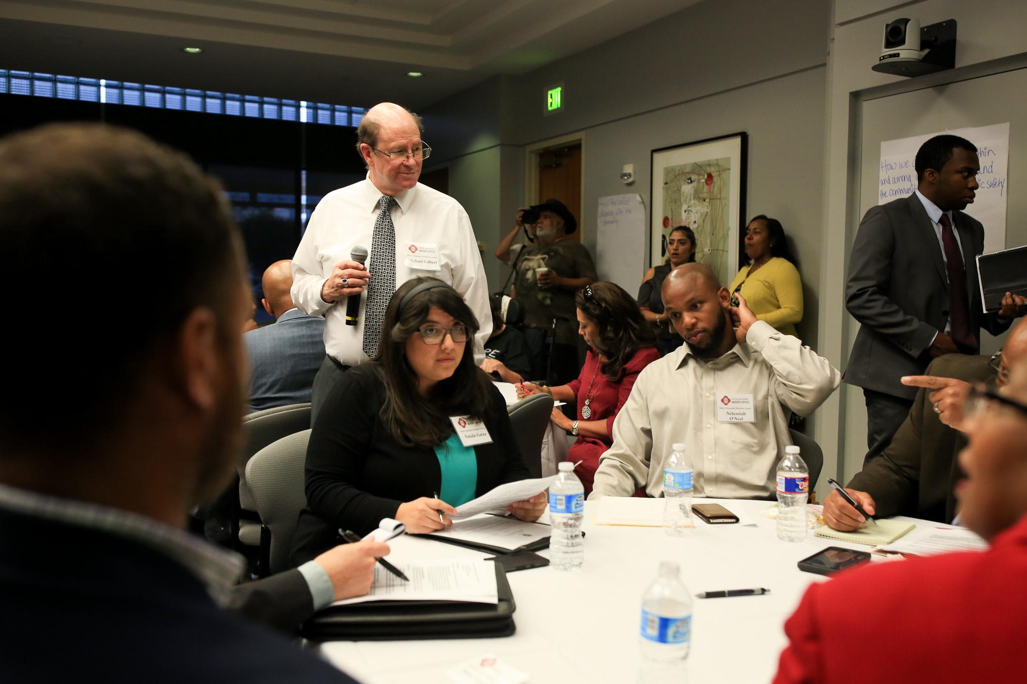 UTSA Professor Michael Gilbert moderates an interactive portion of the meeting.