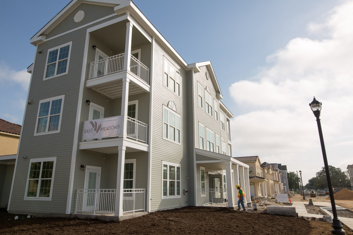 Finishing touches are being performed on the landscape surrounding East Meadows buildings.