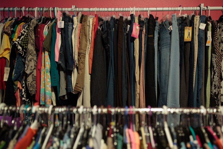 Clothes line the walls from end to end in multiple rooms at SA Threads.