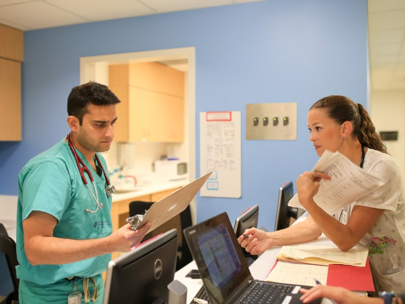 Doctor Srivastava Neeraj speaks with RN Melissa Feist-McCuistion regarding a patient update.