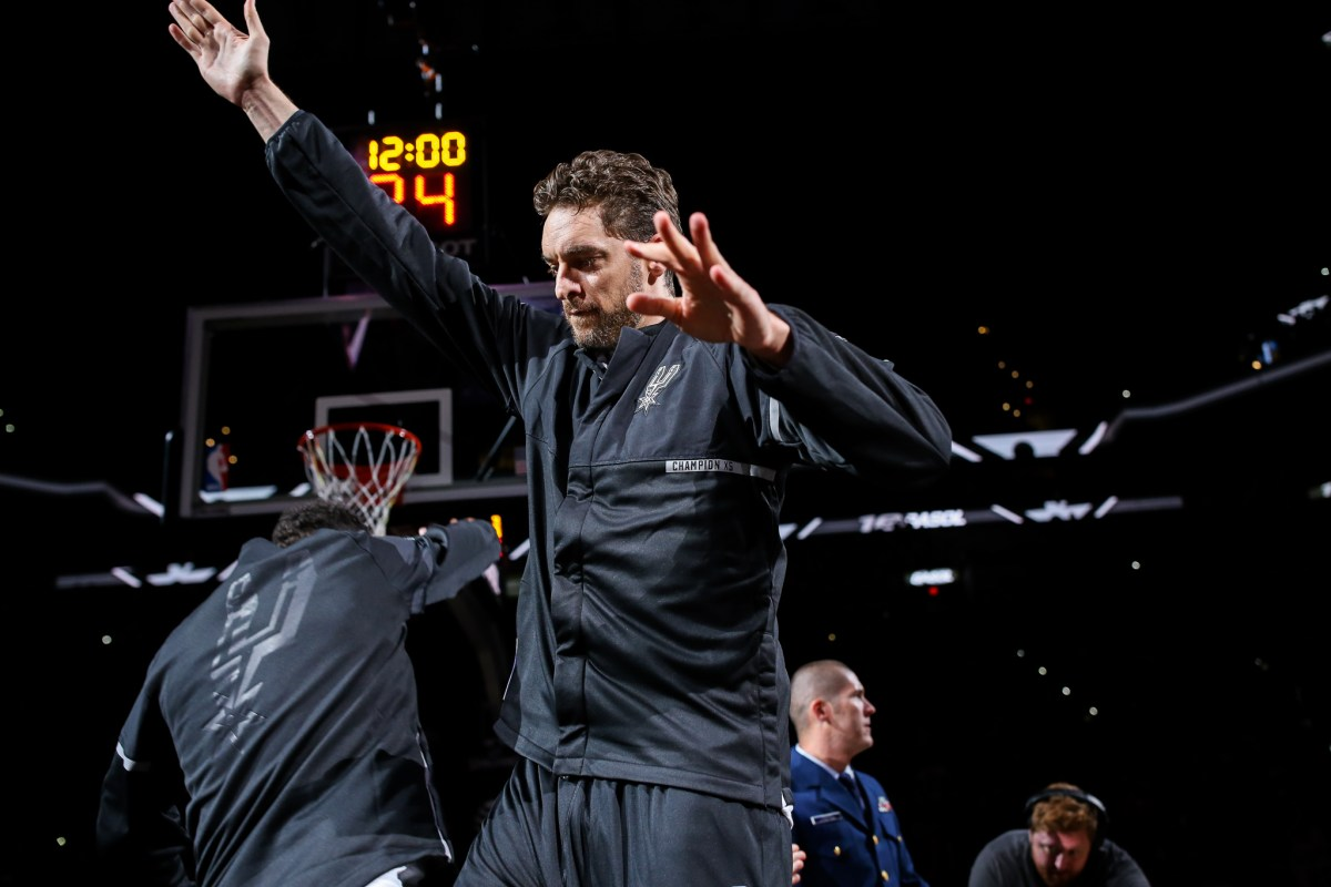 Spurs Center Pau Gasol jumps in the air as he is introduced.