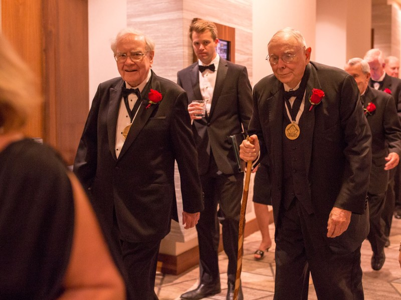 Warren Buffet (left), and Charles Munger walk towards the ballroom before being inducted into the 2016 Texas Business Hall of Fame.