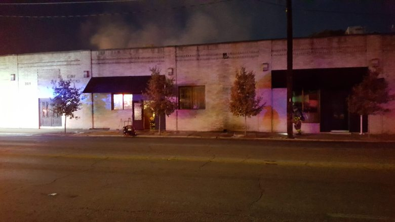 Smoke billows from the building during an early morning fire at Brigid in Southtown.