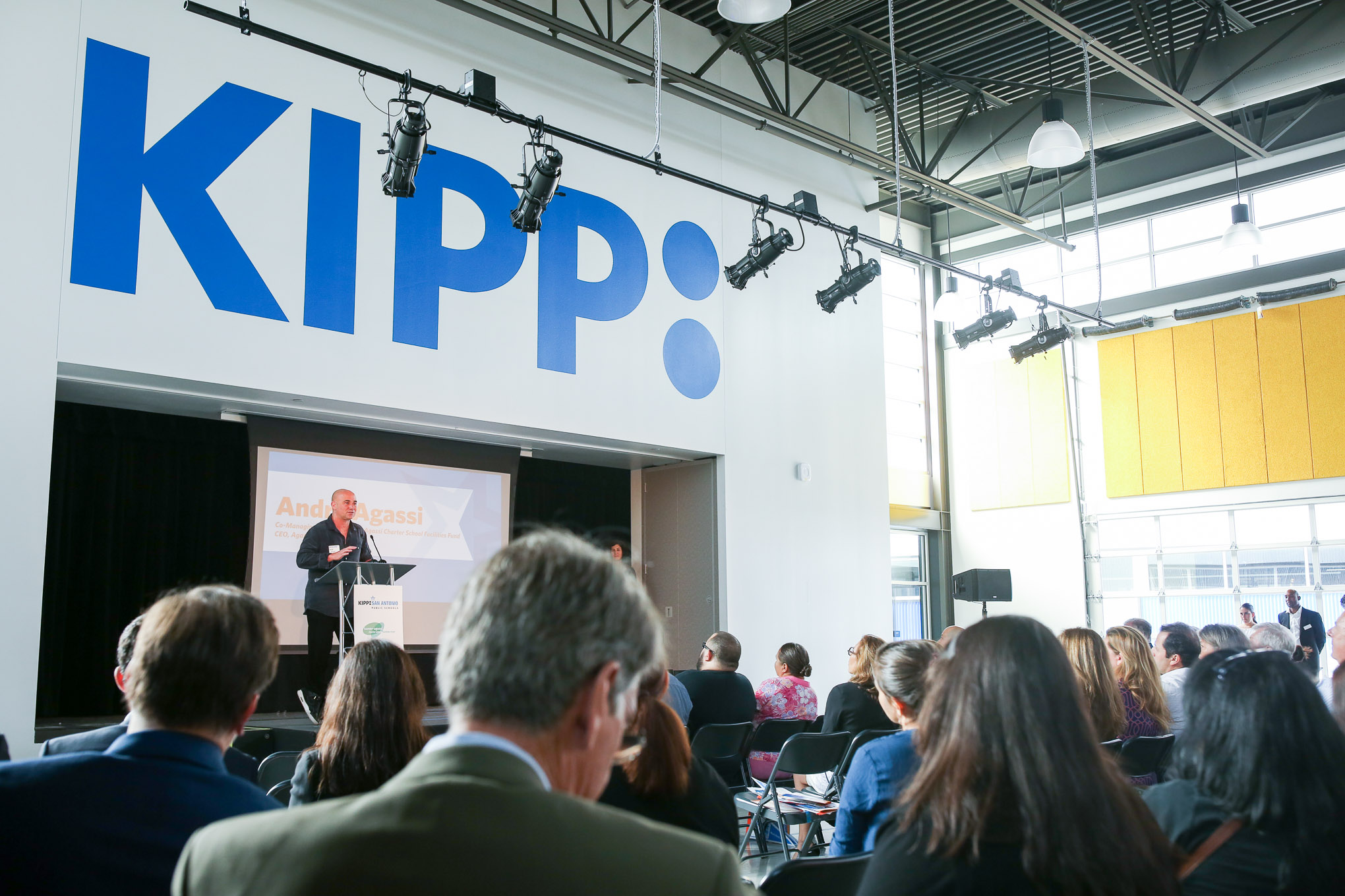 Andre Agassi addresses the audience at KIPP Cevallos. Photo by Scott Ball.