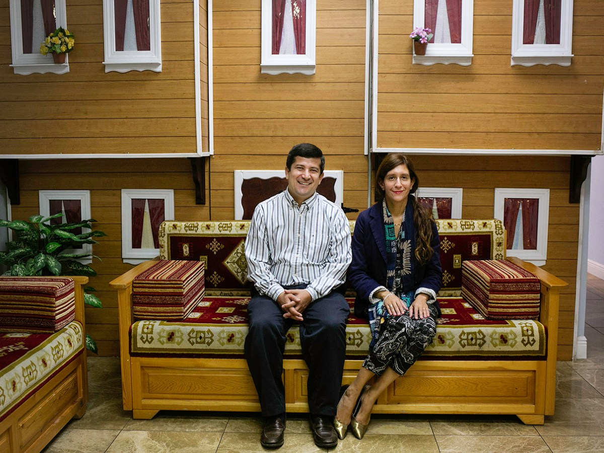 Beytullah and Gabriella Colak sit for a portrait at the Raindrop Turkish House.