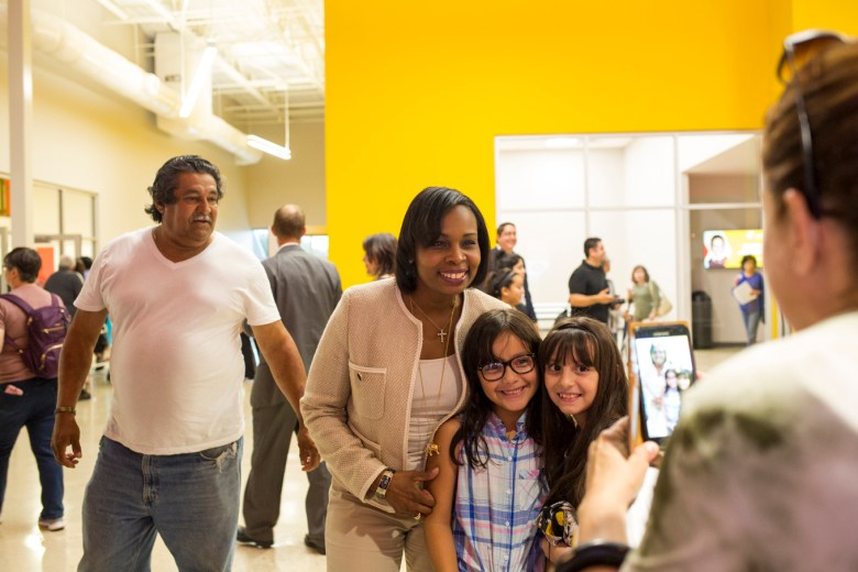 Mayor Ivy Taylor takes a photo with a family at the Mays Family YMCA at Potranco. Photo by Kathryn Boyd-Batstone.
