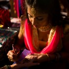 Various henna artists from around the San Antonio area and beyond draw the designs for the thousands of attendees.