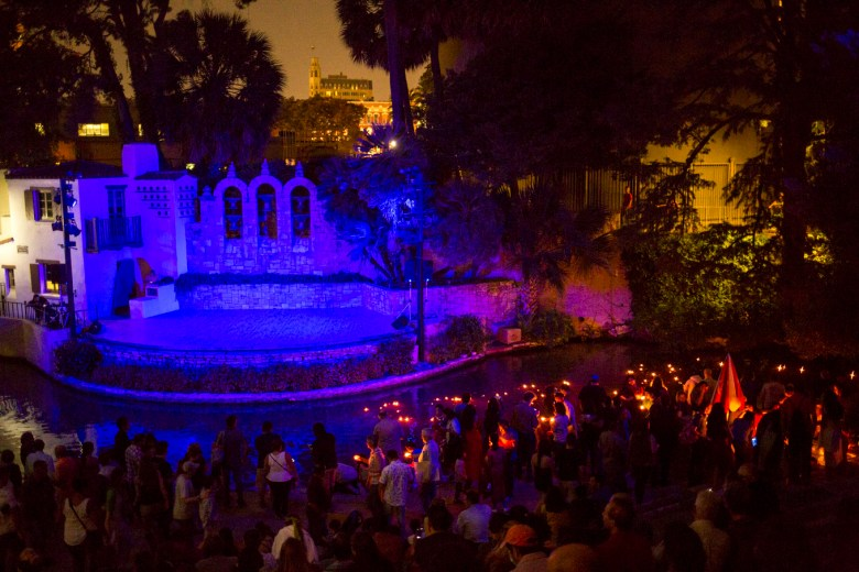 Thousands of people participate in the Diya, or floating candle, ceremony by placing the candles in the San Antonio River.