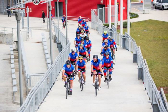 Ride Texas bikers ride up the ramp at the Toyota Field to the sound of cheering welcomers.
