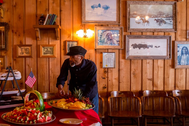 Veteran Marvin Linton makes a plate of food at Acadiana Café, a place that he frequents every week.