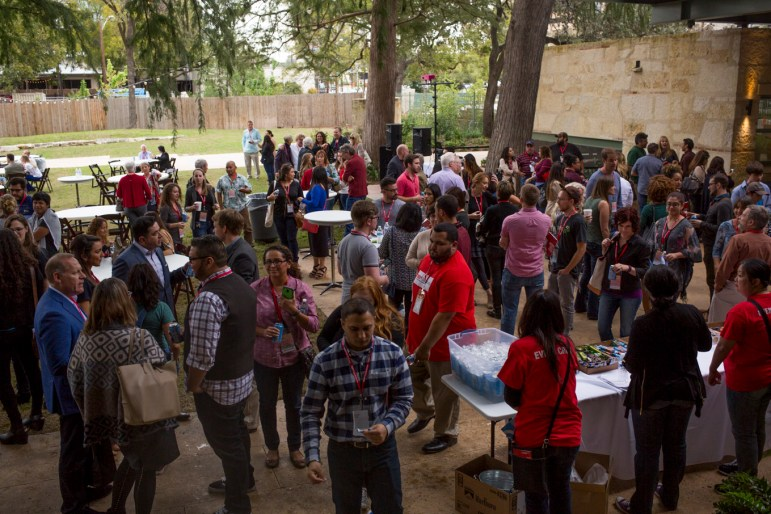 TEDx attendees mingle at the Witte Museum grounds during a snack break.