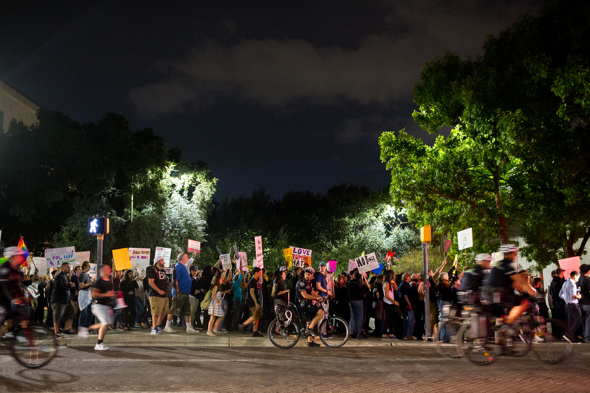 Hundreds of people march along West Commerce Street in protest of Trump.