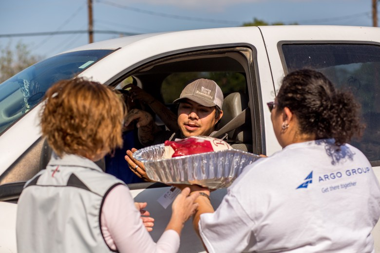 Argo Group members hand out Thanksgiving dinners to help local families in San Antonio.