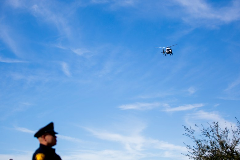 A helicopter flies over Community Bible Church in honor of Detective Marconi.