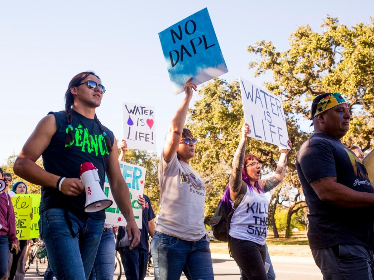 DAPL protestors march along E Sonterra Blvd. towards Texas company Energy Transfer Partners.