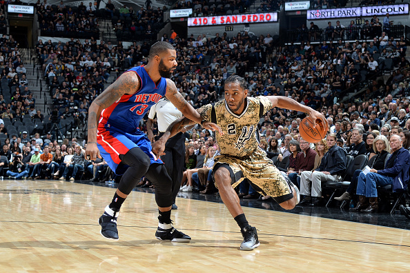 Kawhi Leonard #2 of the San Antonio Spurs handles the ball against Marcus Morris #13 of the Detroit Pistons during the game on November 11, 2016 at the AT&T Center in San Antonio, Texas.