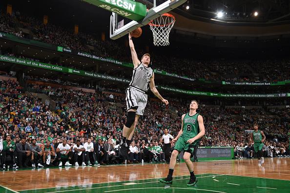 Davis Bertans #42 of the San Antonio Spurs drives to the basket against the Boston Celtics on November 25, 2016 at the TD Garden in Boston, Massachusetts.