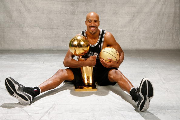 Bruce Bowen #12 of the San Antonio Spurs poses for a portrait with the Larry O'Brien Championship trophy after they won the 2007 NBA Championship with their 83-82 win against the Cleveland Cavaliers in Game Four of the NBA Finals at the Quicken Loans Arena on June 14, 2007 in Cleveland, Ohio. (Photo by Nathaniel S. Butler/NBAE/Getty Images)