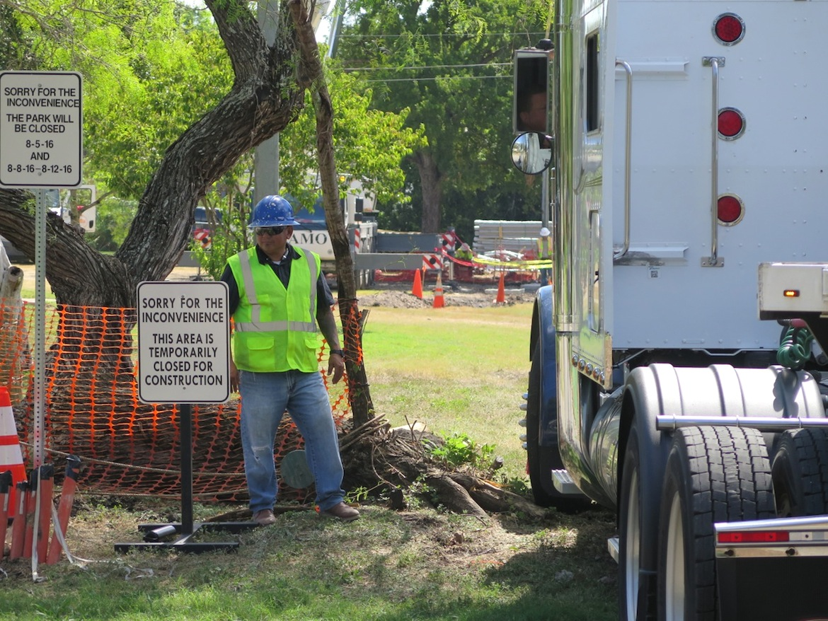 A subcontractor helps guide a semi-truck into Haskin Park in August 2016.