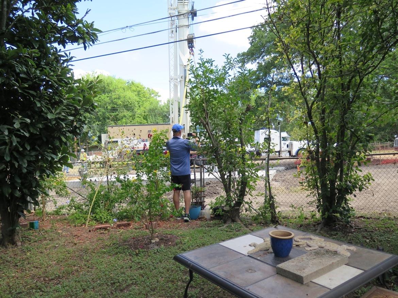 John Whitsett takes a photo of crews installing a Google Fiber network hut in Haskin Park in August 2016.