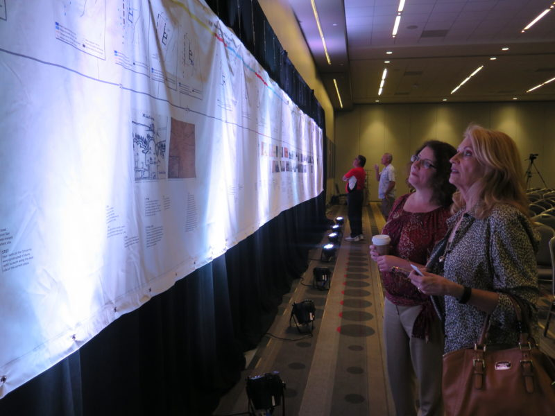 (From left) Terri Rubiola and Sharon Fleming examine the historical timeline of the Alamo.