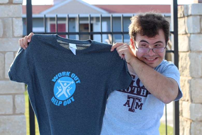 A student at The Academy at Morgan's Wonderland shows his support for WOHO.