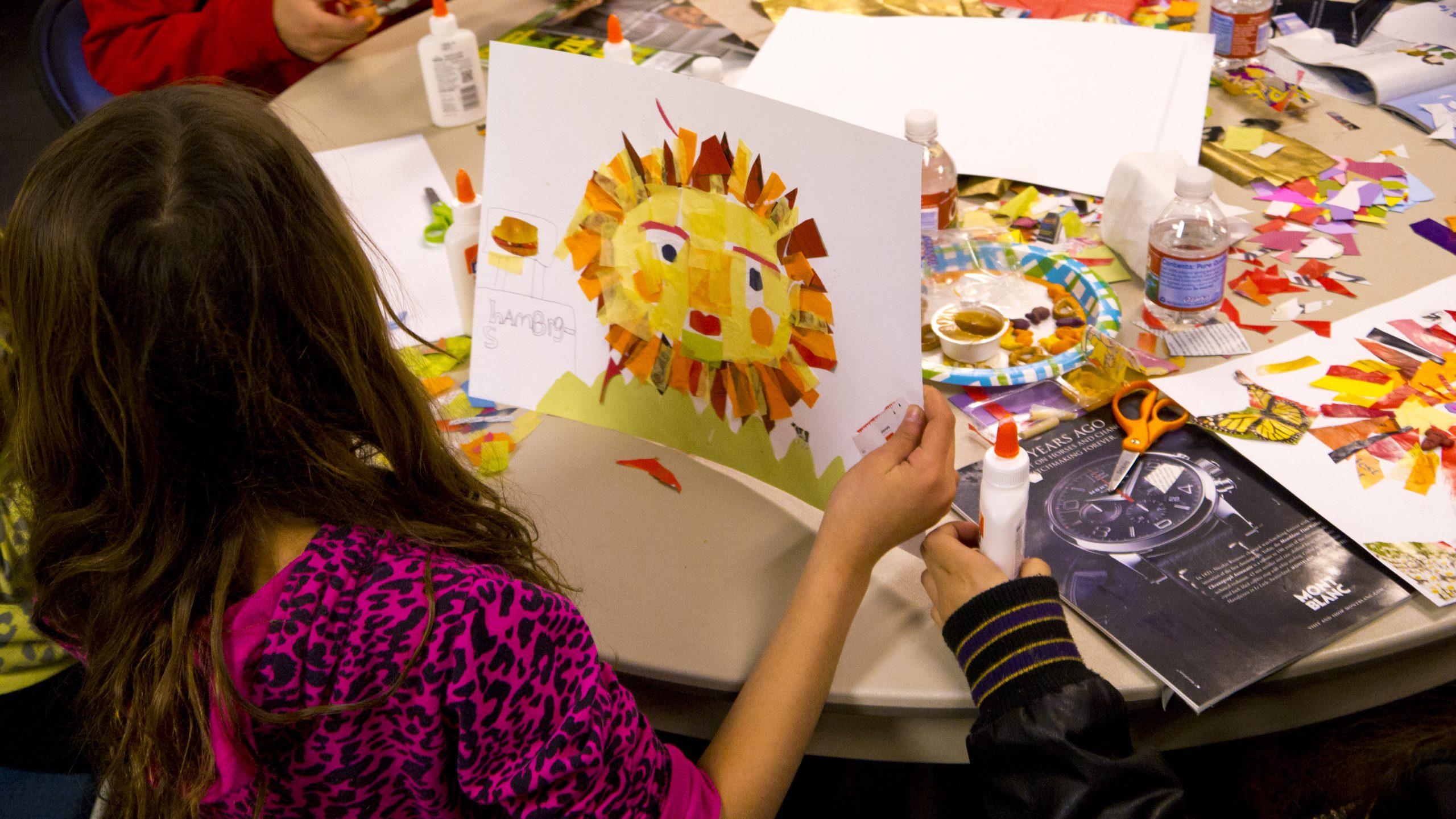 "Children at work in CASA's ""Art and Soul"" program."