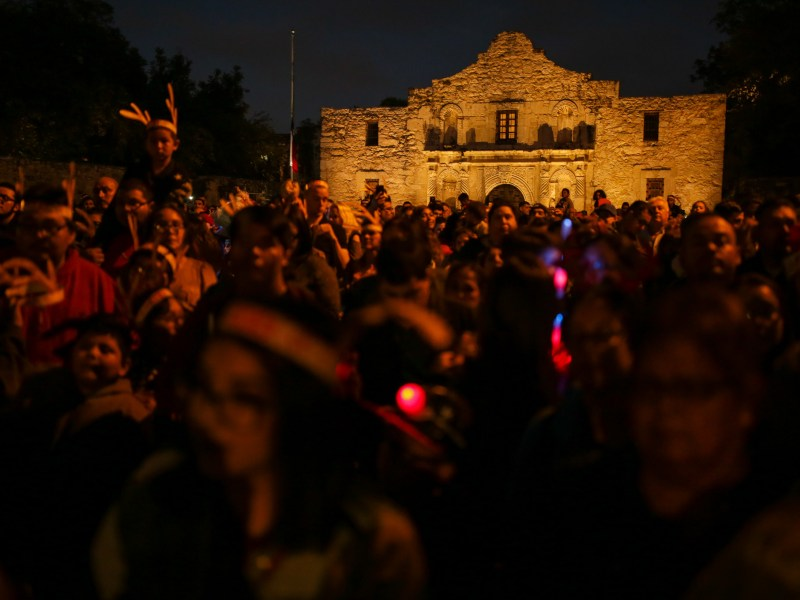 Thousands attend the tree lighting ceremony at Alamo Plaza.