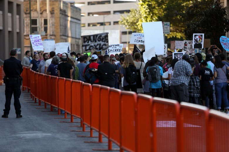 Barricades were lined across the front of Bank of America Plaza to keep crowds contained.