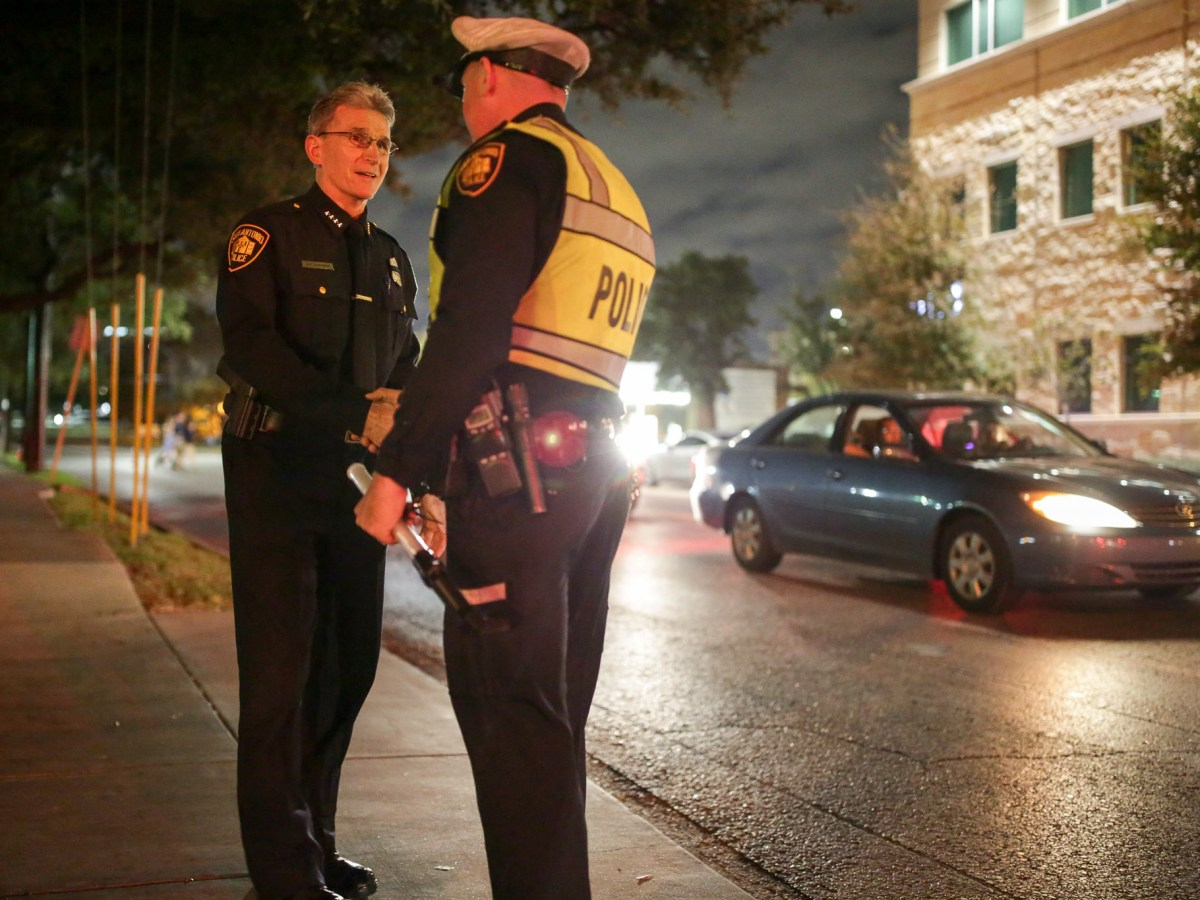 San Antonio Police Chief William McManus shakes hands with an officer outside Porter Loring Mortuary.