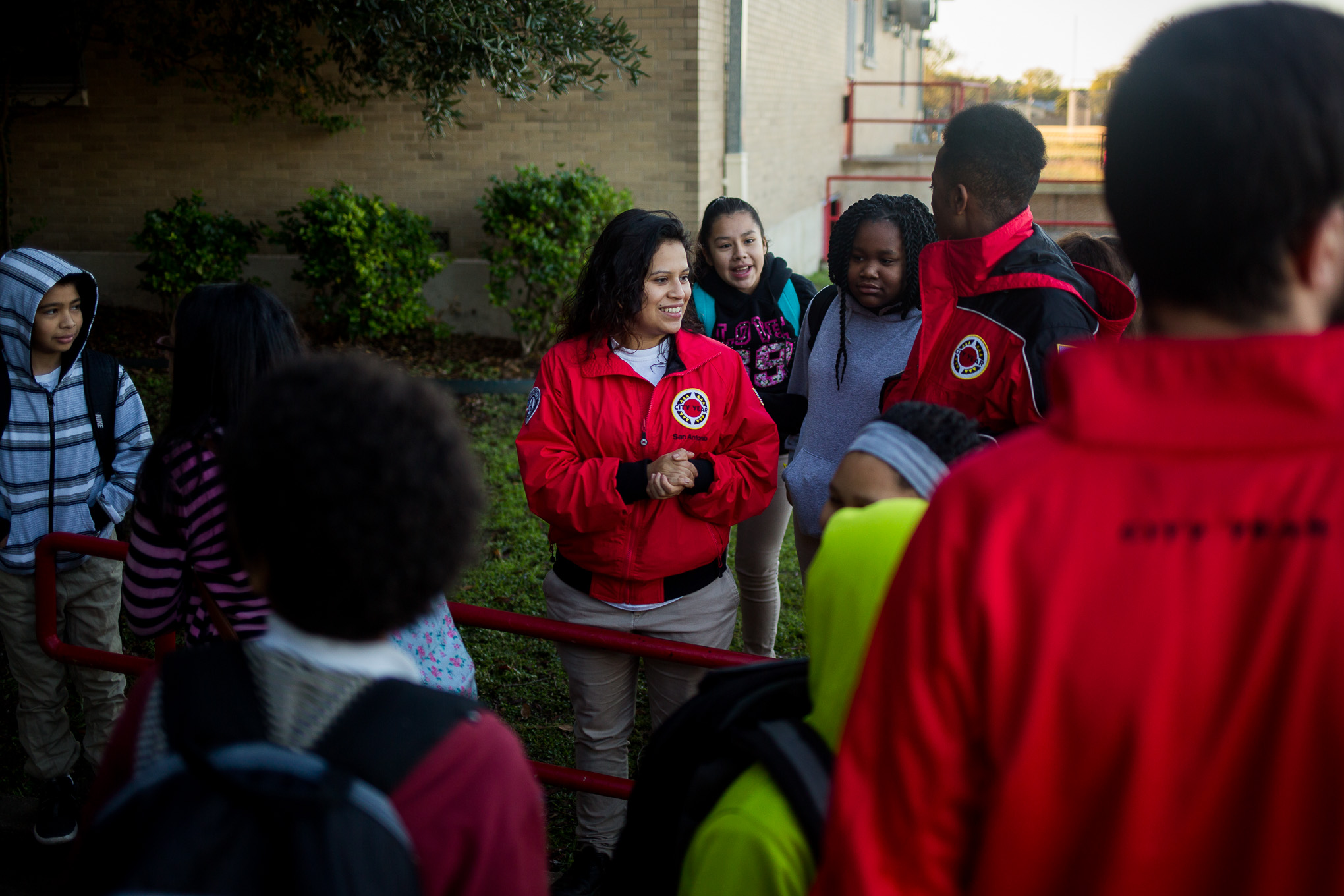 Students congregate around the City Year corps members before the start of the school day.