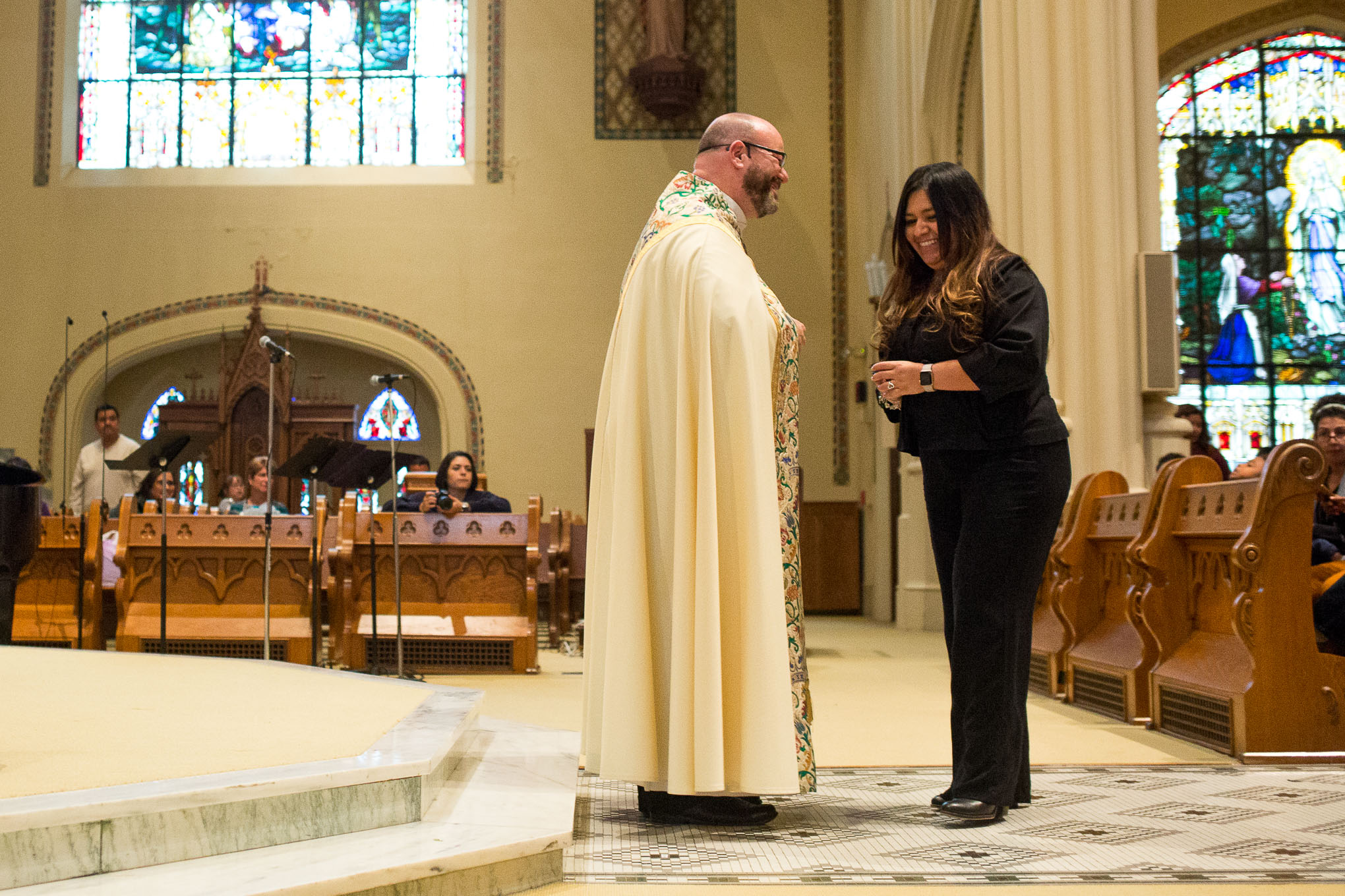 Gina Garcia gets her OLLU pendant blessed at the Sacred Heart Conventual Chapel.
