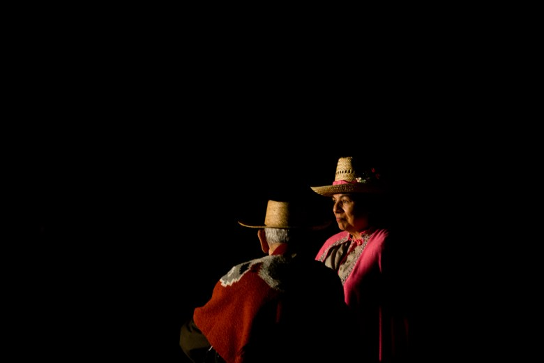 Patricia Perez and Gilbert Perez wait for their entrance in the play Los Pastores: The Shepherds Play.