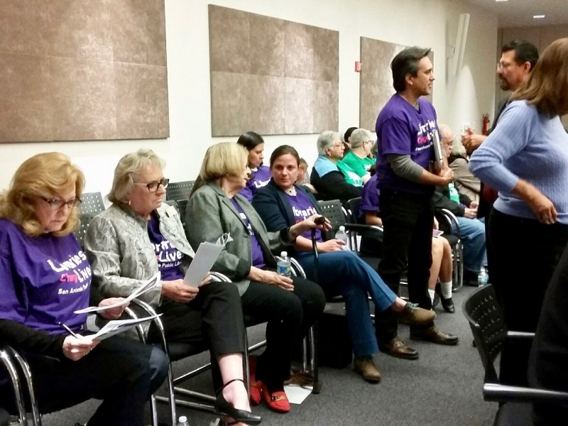Supporters of bond-funded library proposals prepare for the Facility Improvements Bond Committee meeting at the Central Library on Tuesday, Dec. 5, 2016. Photo by Edmond Ortiz