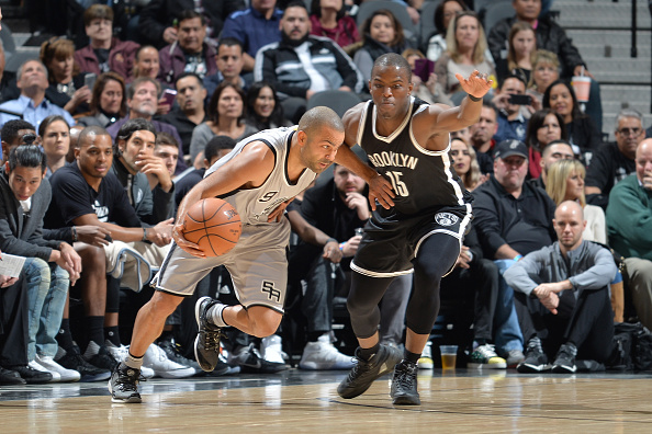 Tony Parker #9 of the San Antonio Spurs drives to the basket against the Brooklyn Nets on December 10, 2016 at the AT&T Center in San Antonio, Texas.