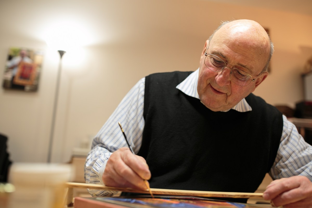 Iconographer Fr. Clyde Rausch demonstrates his work in his studio at the Oblate Renewal Center.