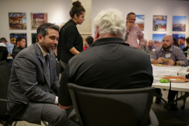 Councilman Roberto Treviño (D1) facilitates the discussion and speaks with local artist Bill Fitzgibbons.