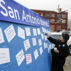 Nirenberg supporter Loretta Van Coppenolle sticks a large piece of paper describing her oppinion of what San Antonio deserves onto a large board gathering community input.