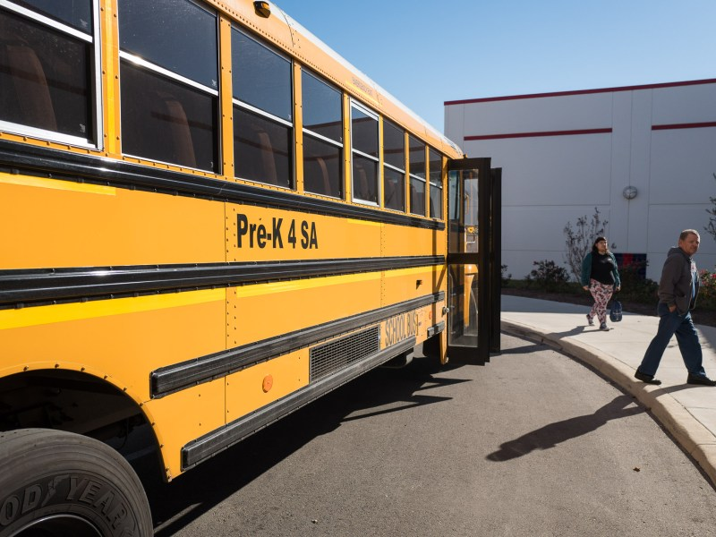 A Pre-K 4 SA school bus picks up children to be taken home for the holiday break.