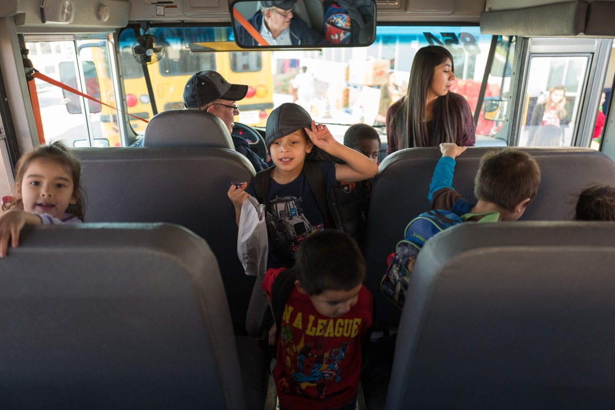 Children arrive onboard the Pre-K 4 SA school bus to be taken home for the holidays.