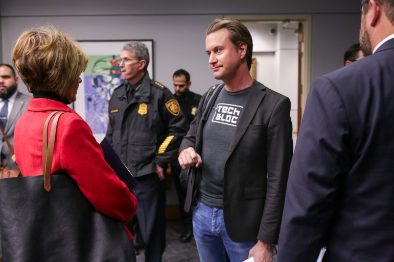 TechBlock Co-Founder David Heard speaks with City Manager Cheryl Sculley following the approval to keep rideshare in San Antonio.