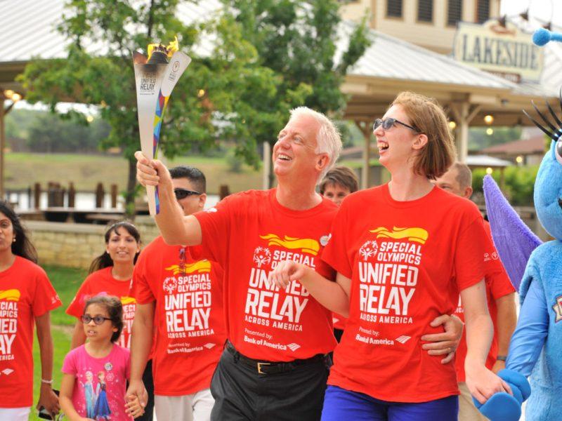 Gordon Hartmans and his daughter Morgan during the Special Olympics Torch Relay at Morgan's Wonderland.