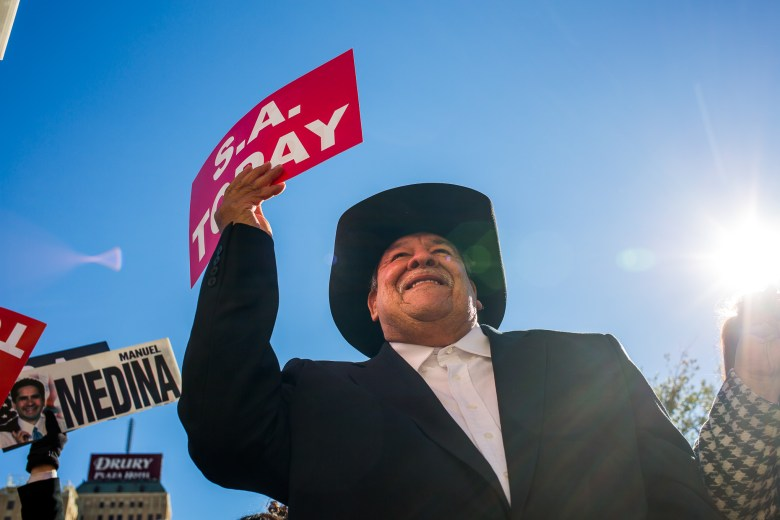 Juan Bernal cheers in support of Manuel Medina during the official campaign announcement in Main Plaza.
